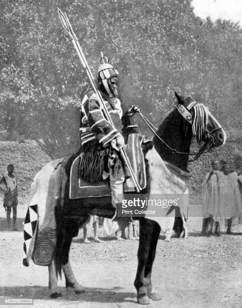 Royal bodyguard in ancient armour northern Nigeria 1936 The man is a bodyguard to the Emir of Fika From Peoples of the World in Pictures edited by...