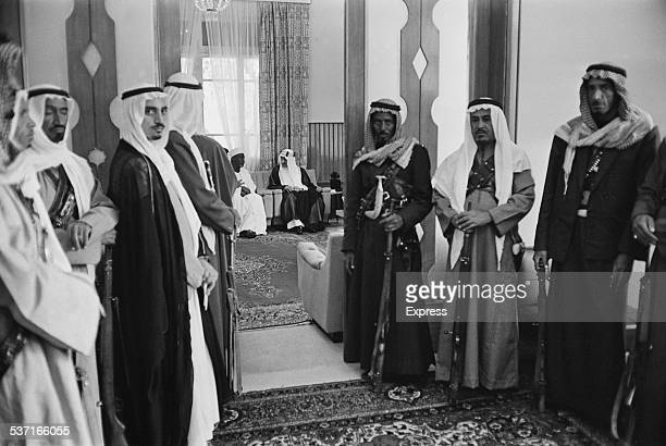 Royal bodyguards waiting in a hallway outside a room where King Faisal of Saudi Arabia has a meeting, 1967.
