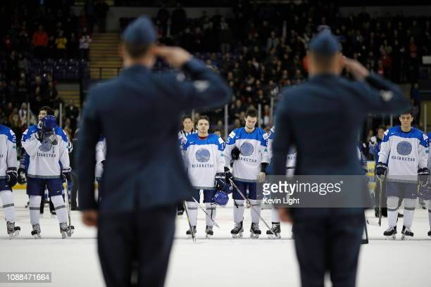 Royal Canadian Air Force members Martin and Duchesne salute towards team Kazakhstan following their 50 loss to Finland at the IIHF World Junior...