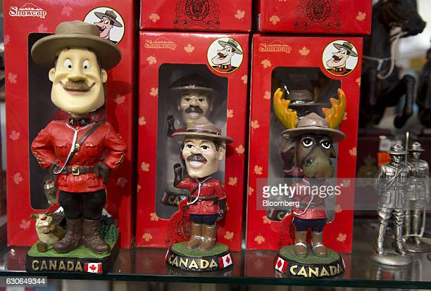 Royal Canadian Mounted Police figurine souvenirs stand on display for sale at a store in Old Montreal Quebec Canada on Tuesday Dec 27 2016 Bloomberg...