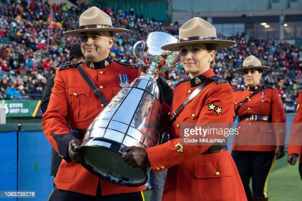 Royal Canadian Mounted Police members bring in the Grey Cup prior to the game between the Calgary Stampeders and the Ottawa Redblacks during the Grey...