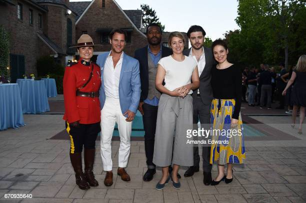 A Royal Canadian Mounted Police Officer actors Sebastien Roberts and Lyriq Bent the Minister of Canadian Heritage The Honourable Melanie Joly and...