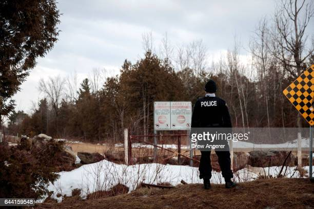 Royal Canadian Mounted Police officer stands at the USCanada February 23 2017 in Hemmingford Quebec Canada In the past month hundreds of people have...