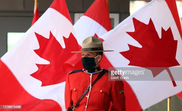 Royal Canadian Mounted Police officer stands guard outside the Senate of Canada prior to the Speech from the Throne September 23, 2020 in Ottawa,...
