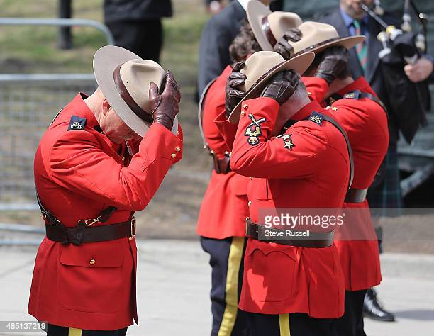 TORONTO ON APRIL 16 Royal Canadian Mounted Police pallbearers remove their hats before carrying in the casket at the state funeral for former federal...