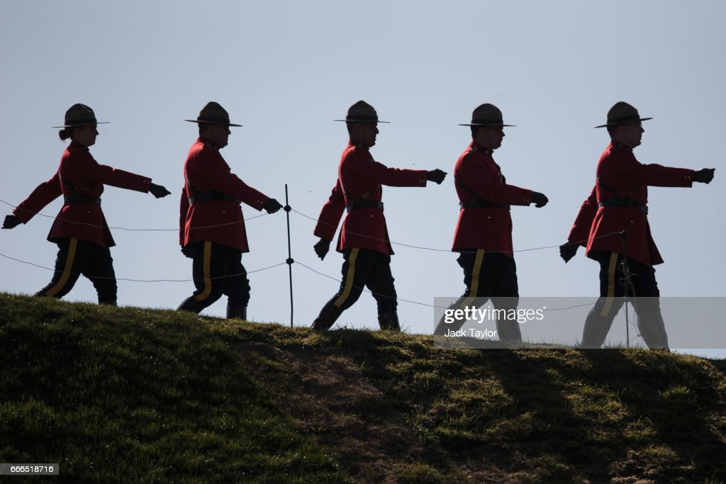 Royal Canadian Mounted Police parade by the Canadian National Vimy Memorial during a Vimy centenary commemorative service on April 9, 2017 in Vimy, France. The Prince of Wales, The Duke of Cambridge and Prince Harry along with Canadian Prime Minister Justin Trudeau and French President Francois Hollande attend the centenary commemorative service at the Canadian National Vimy Memorial. The Battle Of Vimy Ridge was fought during WW1 as part of the initial phase of the Battle of Arras. Although British-led it was mostly fought by the Canadian Corps.