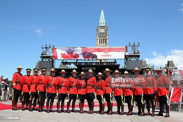 Royal Canadian Mounted Police pose for a photograph during Canada Day Celebrations as they wait to catch a glimpse of Prince William Duke of...