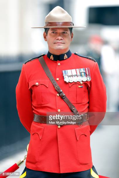 A Royal Canadian Mounted Policeman awaits the arrival of Queen Elizabeth II at Canada House to celebrate Canada's 150th anniversary of Confederation...
