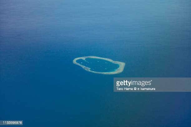 royal captain shoal in spratly islands in the south china sea in philippines daytime aerial view from airplane - 太平洋 ストックフォトと画像