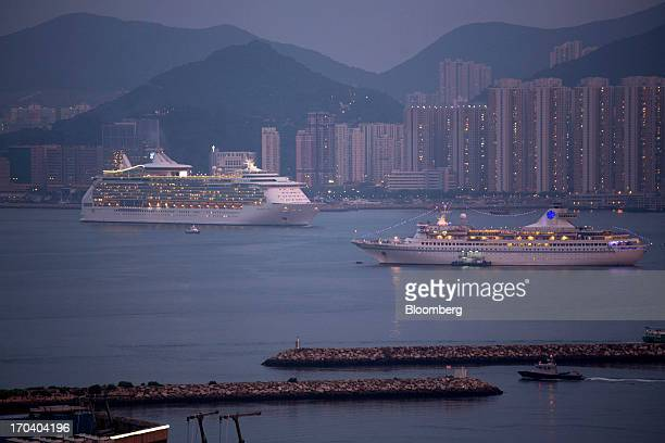 Royal Caribbean Cruises Ltd's Mariner of the Seas ocean liner left sails toward the Kai Tak Cruise Terminal built on the site of the former Kai Tak...