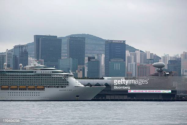 Royal Caribbean Cruises Ltd's Mariner of the Seas ocean liner sits berthed at the Kai Tak Cruise Terminal built on the site of the former Kai Tak...