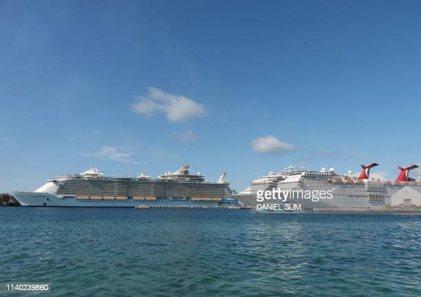 Royal Caribbean ship Allure of the Seas and Carnival Cruise ships Liberty and Elation are seen in Nassau Bahamas on April 29 2019