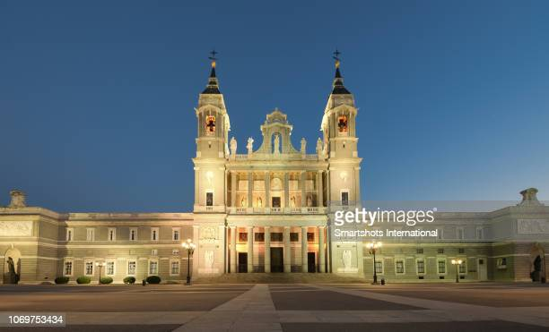 Royal Cathedral of Madrid illuminated at dusk in Madrid, Spain