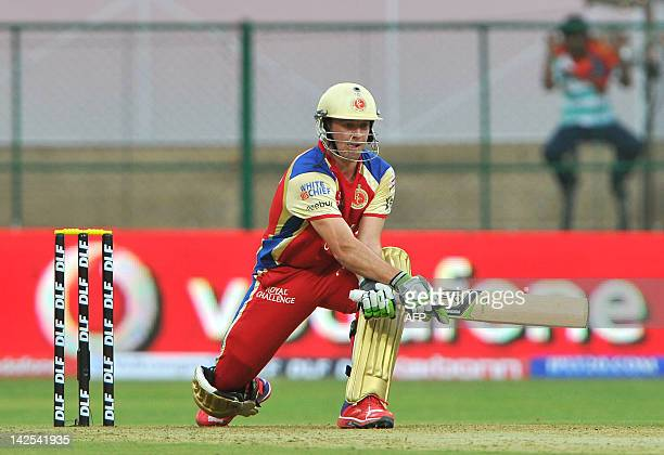 Royal Challengers Bangalore batsman A B DeVilliers plays a shot during the IPL Twenty20 cricket match between Royal Challengers Bangalore and Delhi...