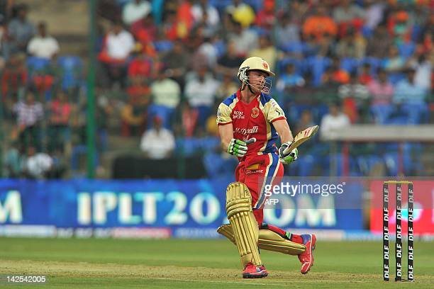 Royal Challengers Bangalore batsman A B DeVilliers reacts after missing a stroke during the IPL Twenty20 cricket match between Royal Challengers...