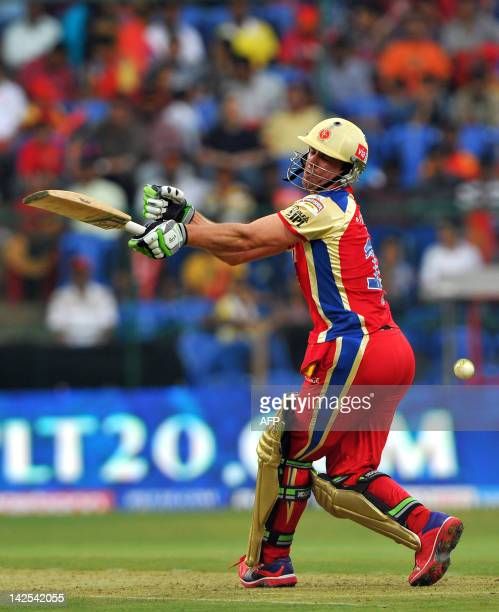 Royal Challengers Bangalore batsman A B DeVilliers reacts after missing a ball during the IPL Twenty20 cricket match between Royal Challengers...