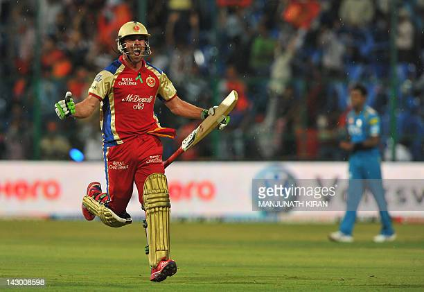 Royal Challengers Bangalore batsman AB DeVilliers celebrates as he runs towards the pavilion after winning the IPL Twenty20 cricket match against...