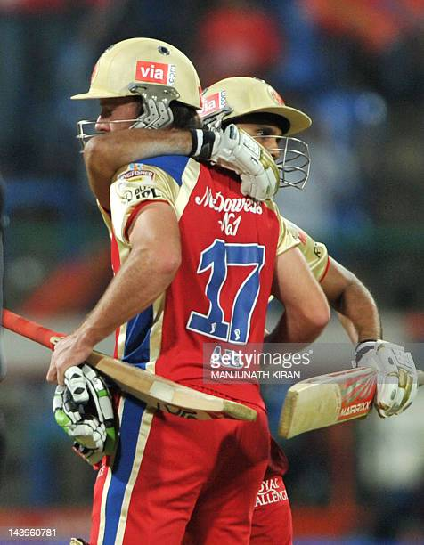 Royal Challengers Bangalore batsman AB DeVilliers is hugged by his team mate Syed Mohammed after RCB won the IPL Twenty20 cricket match against...