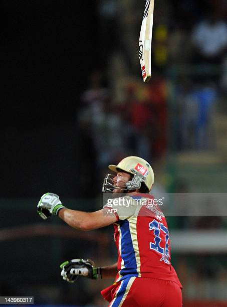 Royal Challengers Bangalore batsman AB DeVilliers looses grip of his bat while playing a shot during the IPL Twenty20 cricket match between Royal...