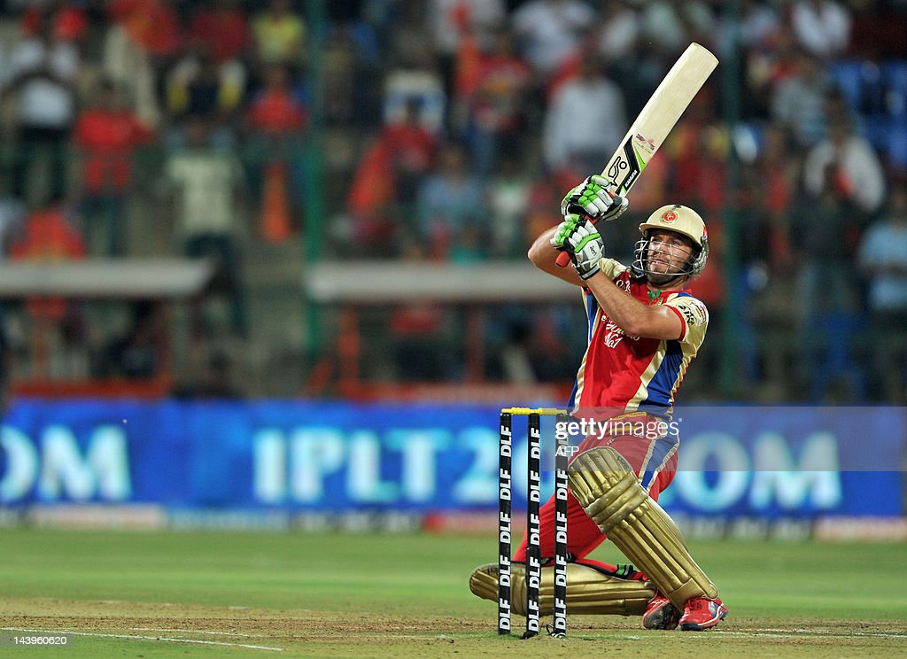 Royal Challengers Bangalore (RCB) batsman AB DeVilliers scores a boundary during the IPL Twenty20 cricket match between Royal Challenger Bangalore and Deccan Chargersat the M. Chinnaswamy Stadium in Bangalore on May 6, 2012. RCB team is chasing a target of 182 set by Deccan Chargers. RESTRICTED TO EDITORIAL USE. MOBILE USE WITHIN NEWS PACKAGE. AFP PHOTO/Manjunath KIRAN