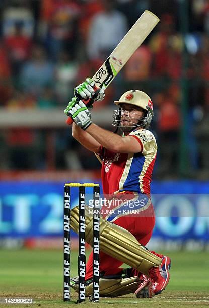 Royal Challengers Bangalore batsman AB DeVilliers scores a boundary during the IPL Twenty20 cricket match between Royal Challenger Bangalore and...