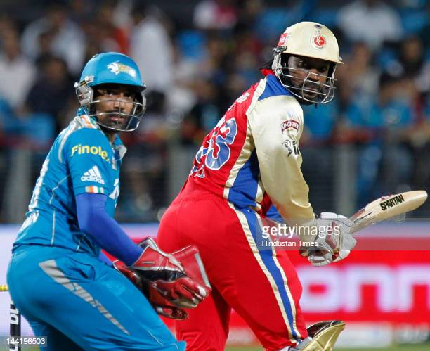 Royal Challengers Bangalore batsman Chris Gayle plays a shot during IPL T20 match played between Pune Warriors India vs Royal Challengers Bangalore...