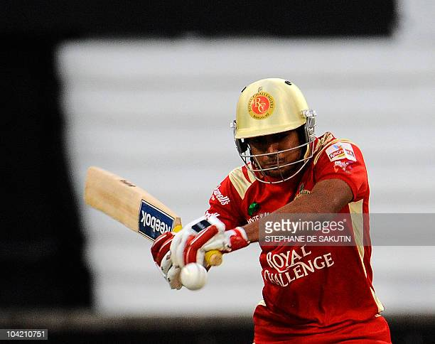 Royal Challengers Bangalore batsman Manish Pandey plays a stroke from South Australian Redbacks bowler Shaun Tait during the Champions League...