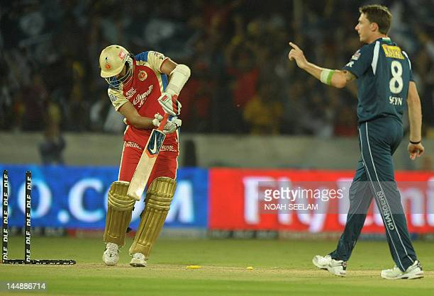 Royal Challengers Bangalore batsman Zaheer Khan looks at his stumps after being bowled by Deccan Chargers bowler Dale Steyn during the IPL Twenty20...