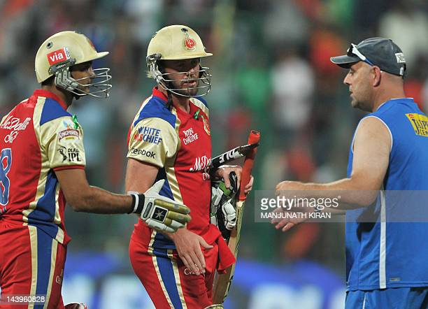 Royal Challengers Bangalore batsmen AB DeVilliers and Syed Mohammed is congratulated by Deccan Chargers team coach Daryl Lehman after the teams...