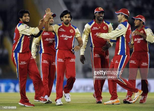 Royal Challengers Bangalore bowler Zaheer Khan celebrates the wicket of Kings XI Punjab batsman Paul Valthaty with teammates during the IPL Twenty20...