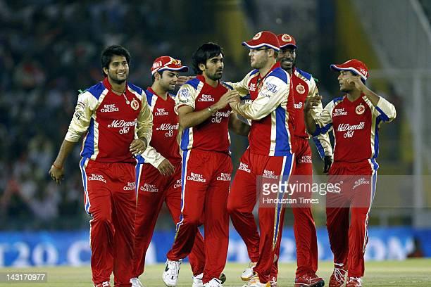 Royal Challengers Bangalore bowler Zaheer Khan celebrating with teammates after the dismissal of Kings XI Punjab batsman Nitin Saini during IPL5 T20...