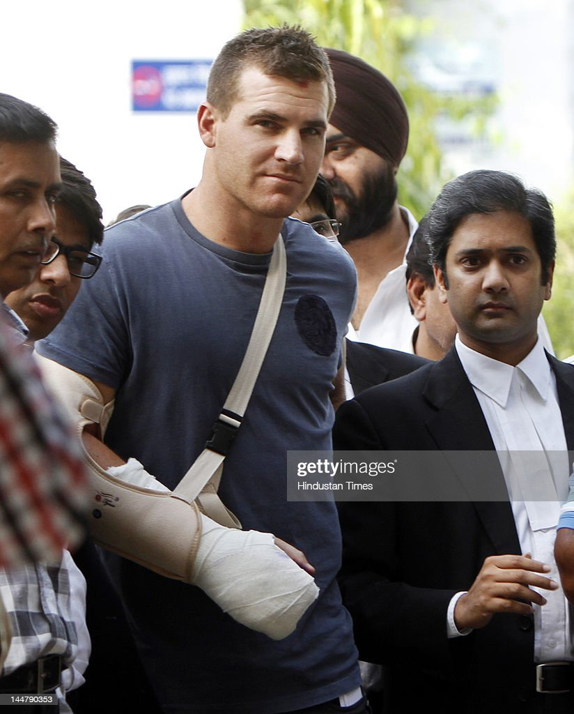 Royal Challengers Bangalore player Luke Pomersbach exits outside the Patiala court after he was granted bail on May 19, 2012 in New Delhi. He was arrested for allegedly molesting an American woman in a five-star hotel here and beating up her fiance after a post-match party.