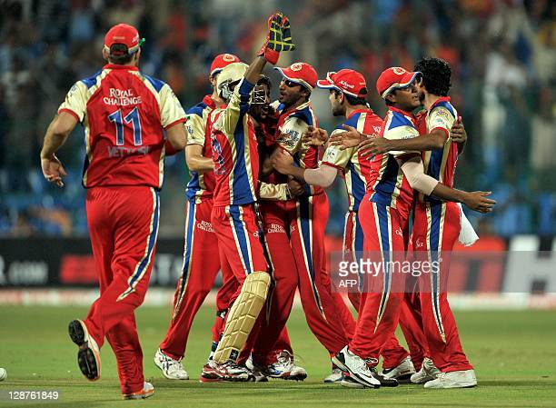 Royal Challengers Bangalore players celebrate the dismissal of unseen NSW Blues batsman Shane Watson during the Champions League Twenty20 first semi...
