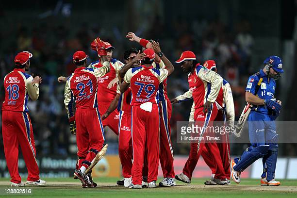 Royal Challengers Bangalore teammates celebrate after the dissmisal of Mumbai Indians batsman Aiden Blizzard during the Champions League Twenty20...