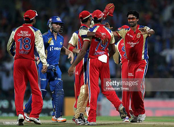 Royal Challengers Bangalore teammates celebrate the dissmisal of Mumbai Indians batsman batsman Aiden Blizzard during the Champions League Twenty20...
