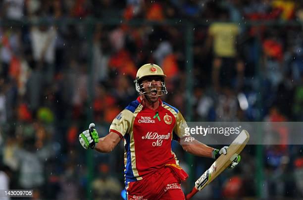 Royal Challengers Bangalore's batsman AB DeVilliers celebrates as he runs towards the pavilion after his team won the IPL Twenty20 cricket match...