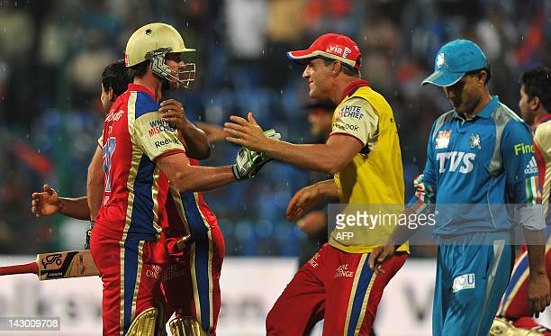 Royal Challengers Bangalore's batsman AB DeVilliers celebrates with his teammates after his team won the IPL Twenty20 cricket match against Pune...