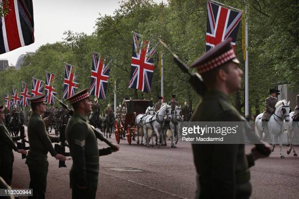 Royal coach travels on The Mall during a military dress rehearsal for the wedding of Prince William and Catherine Middleton on April 27, 2011 in...
