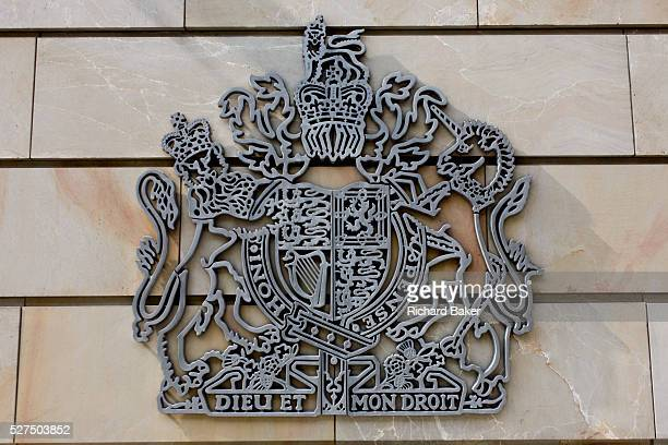 Royal Coat of Arms of the United Kingdom of Great Britain and Northern Ireland the official coat of arms of the British monarch on the exterior wall...