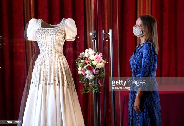 Royal Collection Trust Curator Caroline de Guitut views HRH Princess Beatrice of York's wedding dress on display at Windsor Castle on September 23,...