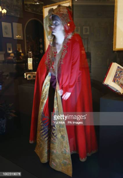 A Royal Collection Trust employee is reflected in Napoleon's cloak 17971805 during a preview of the Prince amp Patron exhibition in the Ball Supper...