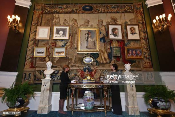 Royal Collection Trust employees during a preview of the Prince amp Patron exhibition in the Ball Supper Room at Buckingham Palace London