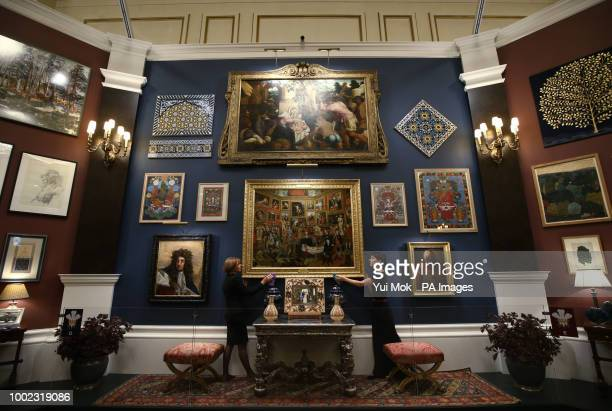 Royal Collection Trust employees dusting the frame of oil painting The Tribuna of the Uffizi 17727 by Johann Zoffany during a preview of the Prince...