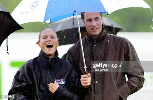 Royal Cousins Prince William And Zara Phillips Shelter Under An Umbrella In A Downpour Of Rain After Taking Part Together In A Fundraising Sports Day...