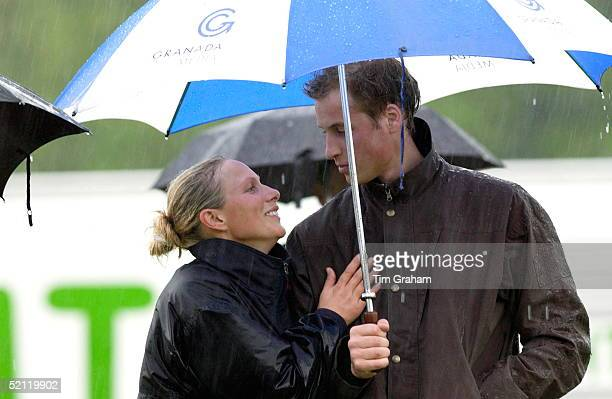 Royal Cousins Prince William And Zara Phillips Shelterunder An Umbrella In A Downpour Of Rain After Taking Part Together In A Fundraising Sports Day...