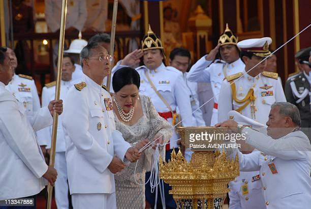 Royal Cremation Of The Princess Galyani Vadhana In Bangkok Thailand On November 15 2008 Thai King Bhumibol Adulyadej and Queen Sirikit lay wood...