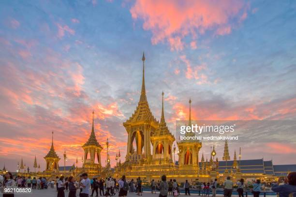 royal crematorium. the royal pyre for royal funeral of h.m. king bhumibol adulyadej at sanamlaung, bangkok, thailand. moving crowd. reflection on the water. - sandalwood stock pictures, royalty-free photos & images