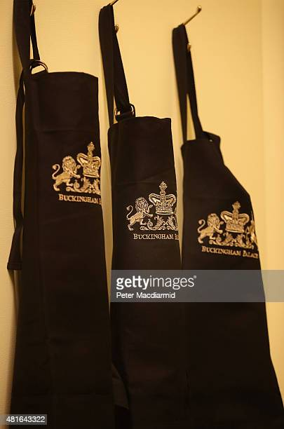 Royal crests are displayed on aprons in a recreation of the Palace kitchens at The Royal Welcome Summer opening exhibition at Buckingham Palace on...