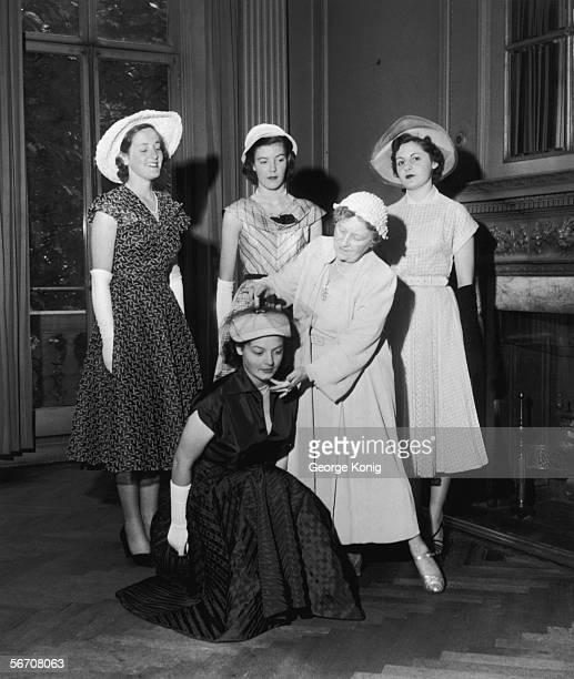 Royal dance instructor Madame Vacani teaches four debutantes how to curtsey to the Queen at Cygnet House Finishing School Staines 1952 The debs are...