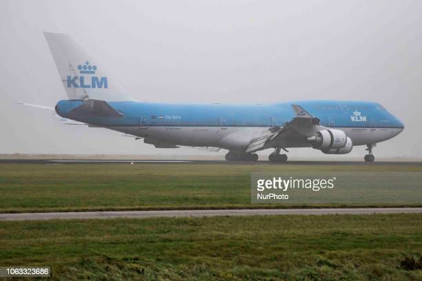 KLM Royal Dutch Airlines Boeing 747400M with registration PHBFH is landing in the mist at Amsterdam Schiphol International Airport in the Netherlands...